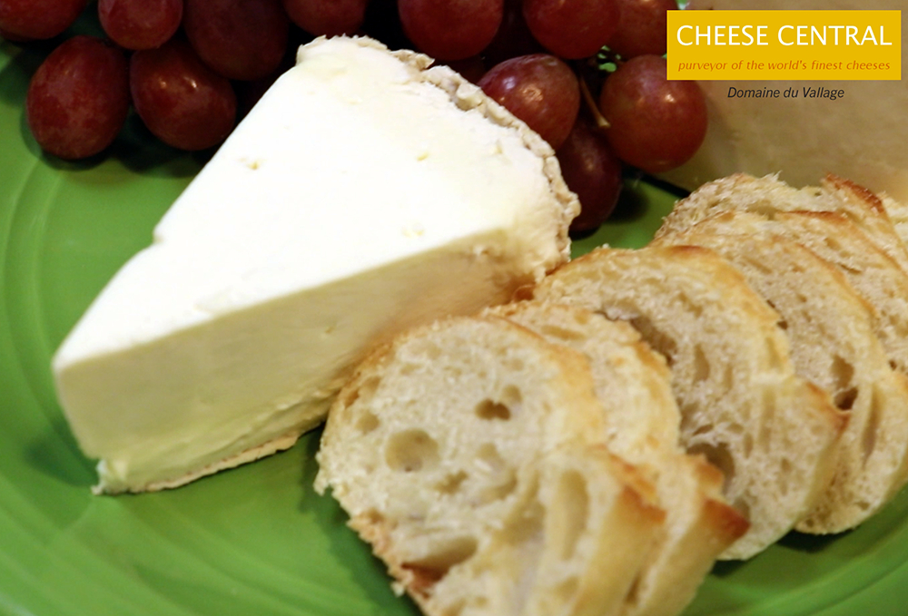 a wedge of Domaine du Vallage with grapes and bread from Cheese Central in Lodi